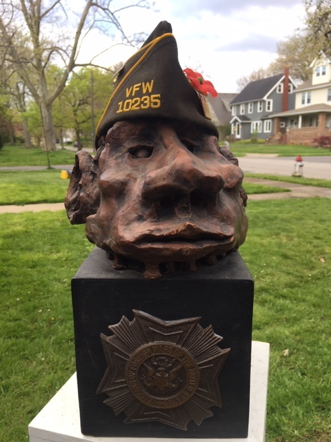 "Pop's VFW Cap from 1988 placed on a clay sculpture I made at Cleveland Heights High School in autumn 1968, in a piece that I call ""Veteran."" He wore it for many years in the Chagrin Falls, Ohio Memorial Day Parade. After the parade he sold mums to the civilians."