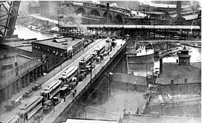 The old Superior Viaduct, (built in 1878), in operation showing a traffic back up in June 1912, that likely backed well into downtown Cleveland during rush hour. This for a boat passing up or down the Cuyahoga River. The backup here resembles many regular backups on many modern limited access highways in America today. (Photo Cleveland State University Library)